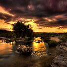 Sunset over the creek by Travis Lord