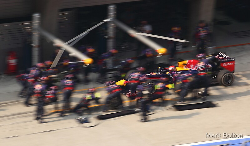 Sebastian Vettel enters the Red Bull Racing Pit