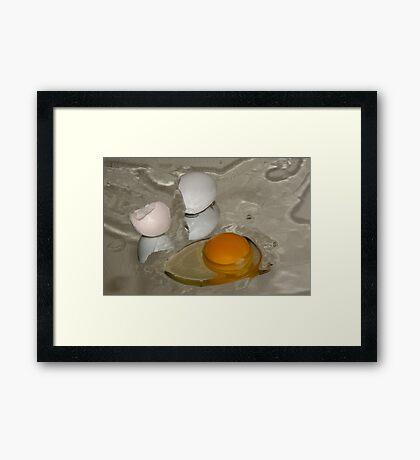 Raw egg and broken egg shell Framed Print