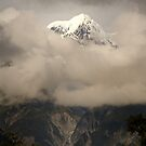 Mount Cook Peaking Through The Clouds by Mick Kupresanin