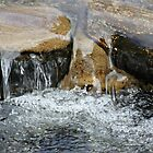 Rocks with water fall by joycemlheureux