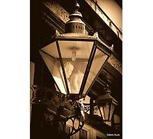 Gargoyles and Pub Lamp Photographic Print