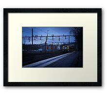Train in the blue Framed Print