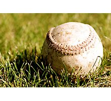 Old Baseball in the Grass Photographic Print