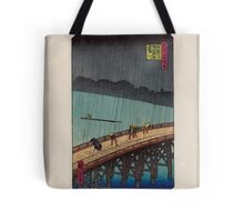 Pedestrians crossing a bridge during a rain storm 001 Tote Bag