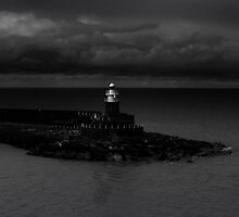 Stormy Fishguard Lighthouse by CHINOIMAGES