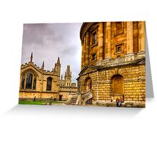 A couple sit outside the Radcliffe Camera in Oxford Greeting Card