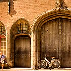A couple stop for a rest in Bruges by Elana Bailey