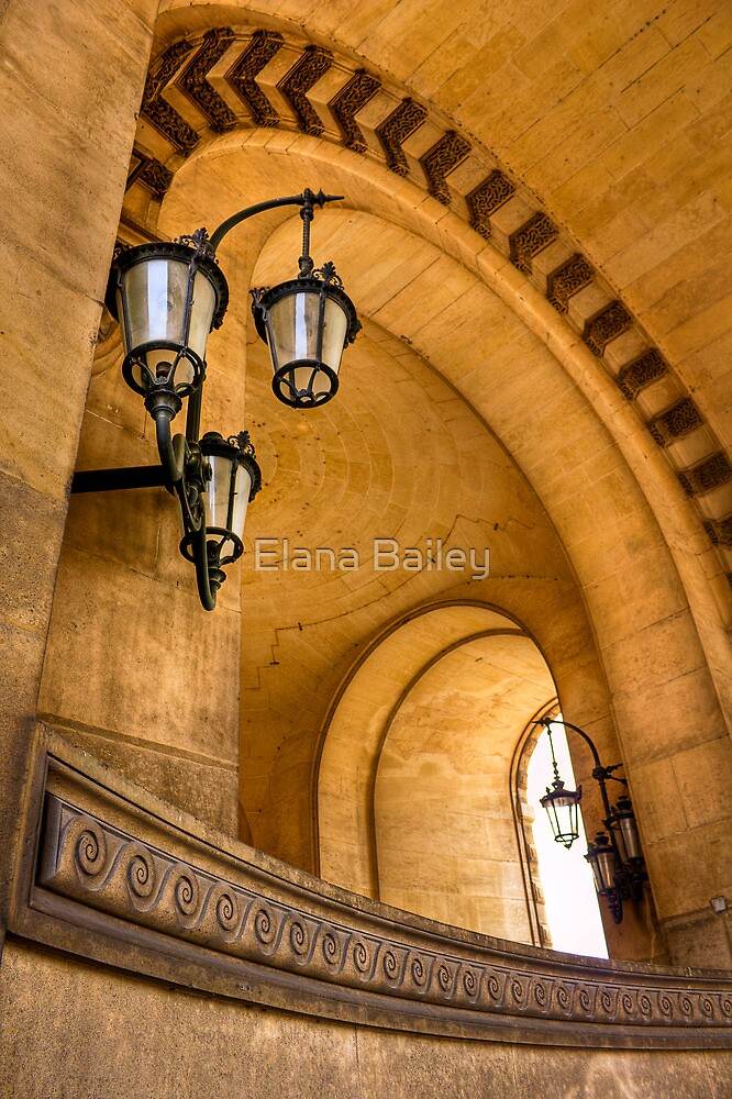 Lamps and curves at the Louvre in Paris by Elana Bailey