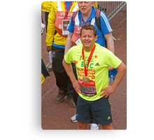 Mike Bushell  BBC presenter poses with his london Marathon medal Canvas Print