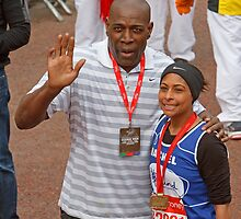 Frank Bruno poses with a London Marathon runner by Keith Larby