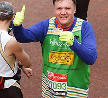 Ed Balls poses with his medal after finishing the London Marathon by Keith Larby