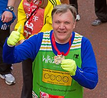 Ed Balls MP poses with his medal after finishing the London Marathon by Keith Larby