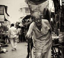 Elderly man walking by Aurobindo Saha