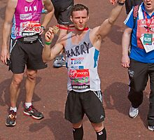 Harry Judd from McFly poses with his medal after finishing the London Marathon by Keith Larby