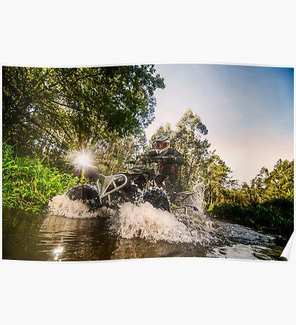 Quad rider through water stream Poster
