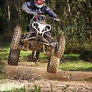 Quad rider jumping by homydesign