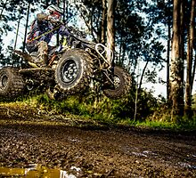 Quad rider jumping by homydesign