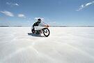 Suzuki Gt 750 at full throttle on the salt by Frank Kletschkus