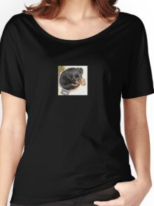 Female Rottweiler Puppy Curled In A Food Bowl Women's Relaxed Fit T-Shirt