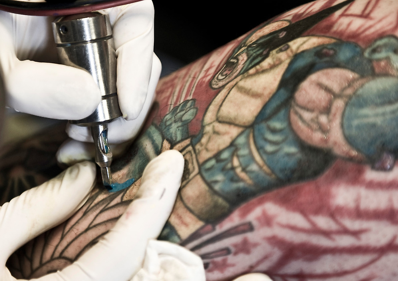 Tattooing Wolverine.  by sallyrose1