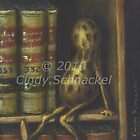 Peanut in Bookcase by Cindy Schnackel