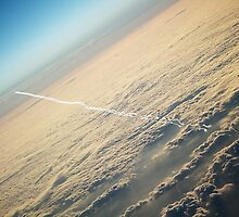 Vapour trails from above by Designer023