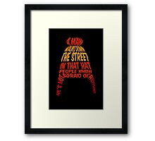 A man walks down the street... Framed Print