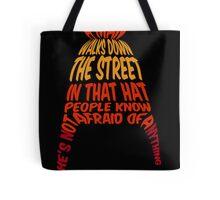 A man walks down the street... Tote Bag
