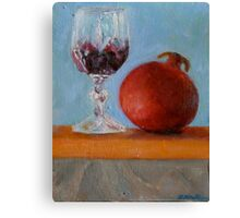 pomegranate and glass of red wine on a book Canvas Print