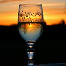 A glass of wine at sunset an evening in May by Trine