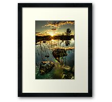 Sunset by a small lake Framed Print