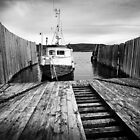 Motorboat moored on the fjord by DmiSmiPhoto