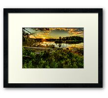 Small boat in the sunset Framed Print