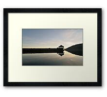 Small house reflected in the waters Framed Print