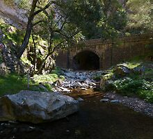 Stone bridge by a creek by PhotosByG