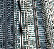 Hong Kong high rise apartment blocks in the sunshine by Jamie Parker