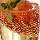 Strawberry and bubbles in sparkling wine by Susanna Hietanen