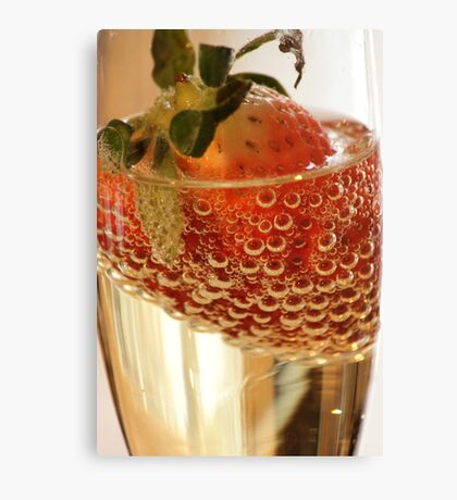 Strawberry and bubbles in sparkling wine Canvas Print