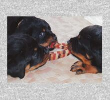 Three Rottweiler Puppies In A Tug Of War Kids Tee