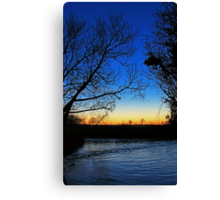 Silhouetted trees at sunset creek. Canvas Print
