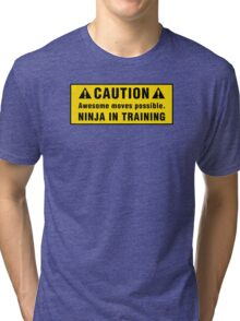 Caution: Awesome moves possible. Ninja in training. Tri-blend T-Shirt