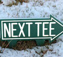 next tee sign in winter snow by morrbyte