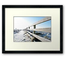 snow covered fenced path on cliff edge walk Framed Print