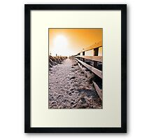 snow covered frozen path on cliff fenced walk at sunset Framed Print
