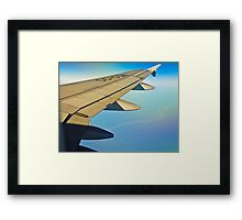 Between clouds, air and earth. Framed Print