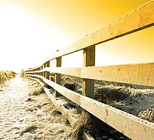 snow covered freezing path on cliff fenced walk at sunset by morrbyte