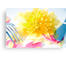 knife and fork isolated with dahlia and rose petals Canvas Print