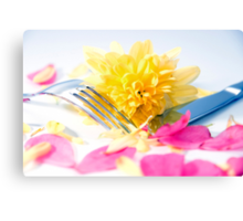 silver knife and fork isolated with dahlia and rose petals Canvas Print