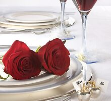 Wine and roses on a wedding table by photolcu